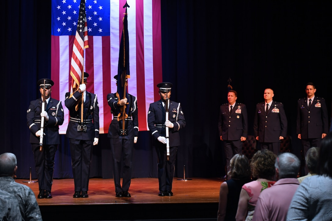 Airmen present the colors.