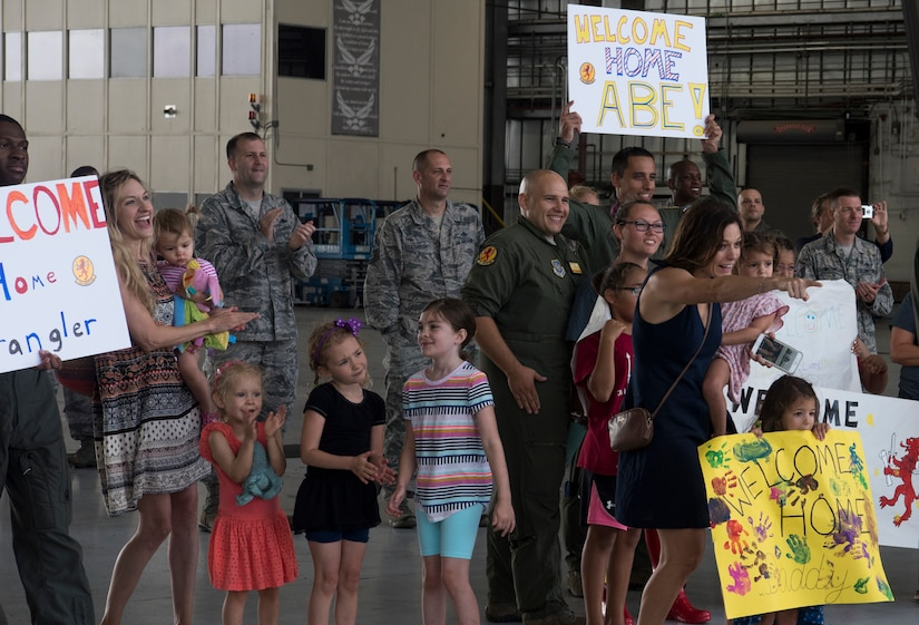 Family and friends welcome home Airmen from the 16th Airlift Squadron August 2, 2018, at Joint Base Charleston S.C. The 16th AS Airmen managed to complete a total of 1,045 sorties over a span of 2,212 hours, moving 35.6 million pounds of cargo to include 4,980 pallets and 10,914 passengers during their three-month tour in the Air Force Central Command area of responsibility.