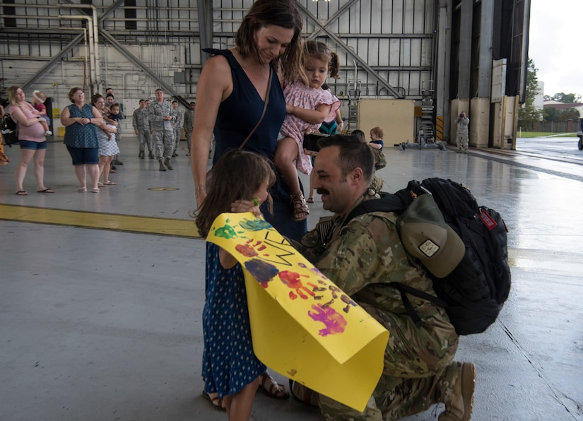 Maj. Ben Buxton, 16th Airlift Squadron assistant director of operations, is reunited with his family August 2, 2018, at Joint Base Charleston S.C.