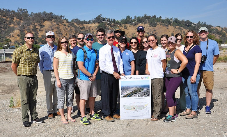 Students and instructors with the U.S. Army Corps of Engineers Planning Associates program, along with representatives from the City of Los Angeles and other agencies pose for a picture July 25 at a site near the LA River. The city recently purchased the 42 acres of land for ecosystem restoration.