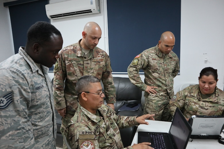 Air Advisors assigned to the 571st Mobility Support Advisory Squadron oversee a group of instructors from the National Air and Naval Service of Panama, also known as SENAN, as they create lesson plans for materiel management classes at the Panama Pacificó Air Base in Panama. This year marked a milestone event for the 571st MSAS, as this was the first time they created and administered an academic instructor course for partner nation service members. The SENAN instructors received instruction on effective presentation and briefing skills and had the opportunity to create lesson plans, which they eventually taught to other SENAN students within their duty specialties. (U.S. Air Force Photo by Staff Sgt. Anthony Colon-Matos)