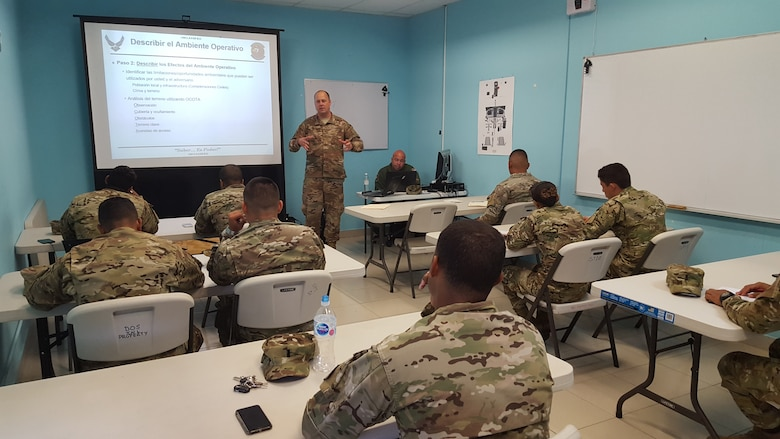 Master Sgt. Christopher White, 571st Mobility Support Advisory Squadron air advisor, instructs students from the National Air and Naval Service of Panama, also known as SENAN, on the fundamentals of intelligence operations at Panama Pacificó Air Base, in Panama. Approximately 235 hours of assessments, seminars, and hands-on practicum took place at five bases within the Panama City location, graduating 63 SENAN personnel from multiple duty specialties. (U.S. Air Force Photo by Lt. Col. Christopher Shea)