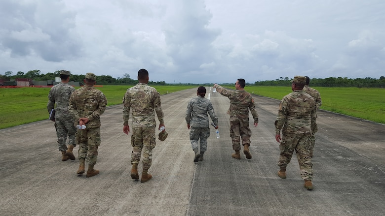 Air Advisors assigned to the 571st Mobility Support Advisory Squadron and students from the National Air and Naval Service of Panama, also known as SENAN, conduct a runway assessment at the forward operation location of Nicanor Air Base in Panama. Approximately 235 hours of assessments, seminars, and hands-on practicum took place at five bases within the Panama City location, graduating 63 SENAN personnel from multiple duty specialties. (U.S. Air Force Photo by Lt. Col. Christopher Shea)