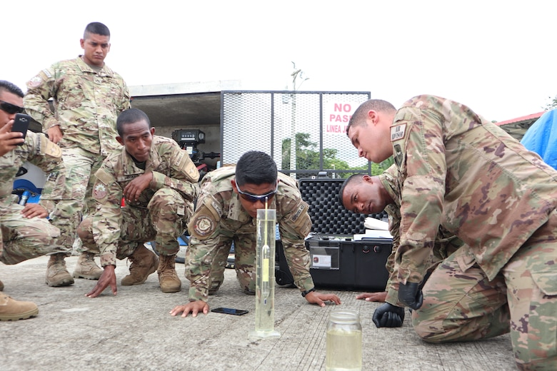 Staff Sgt. Anthony Colon-Matos, 571st Mobility Support Advisory Squadron air advisor, instructs students from the National Air and Naval Service of Panama, also known as SENAN, on proper aircraft fuel quality testing procedures at the forward operating location of Nicanor Air Base in Panama. Approximately 235 hours of assessments, seminars, and hands-on practicum took place at five bases within the Panama City location, graduating 63 SENAN personnel from multiple duty specialties. (U.S. Air Force Photo by Capt. Stephanie Kaari)