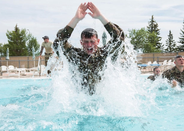 An Airman with the 91st Security Forces Group completes water exercises during the Tactical Response Force tryouts Minot Air Force Base, N.D., July 18, 2018. Tryouts were 15-hours long with multiple physical activities such as a 15-minute assessment, pool exercises in and out of the water, leadership challenges and a red man practical. (U.S. Air Force photo by Airman 1st Class Alyssa M. Akers)