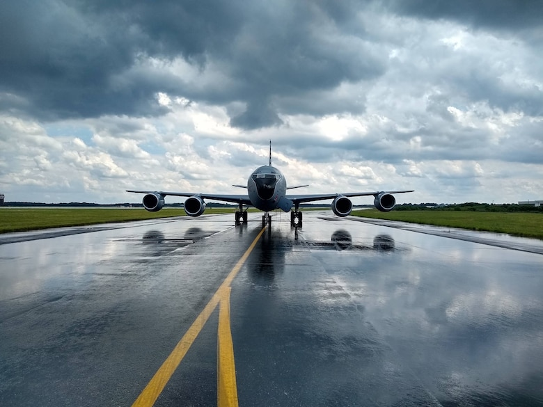 A 108th Wing KC-135R Stratotanker sits on the taxiway at Joint Base McGuire-Dix-Lakehurst, N.J. during a rainstorm during a recent engine running crew change exercise. (U.S. Air National Guard photo by Lt. Col Richard Friendlich)
