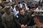 Guatemalan President Jimmy Morales speaks with U.S. Marines.