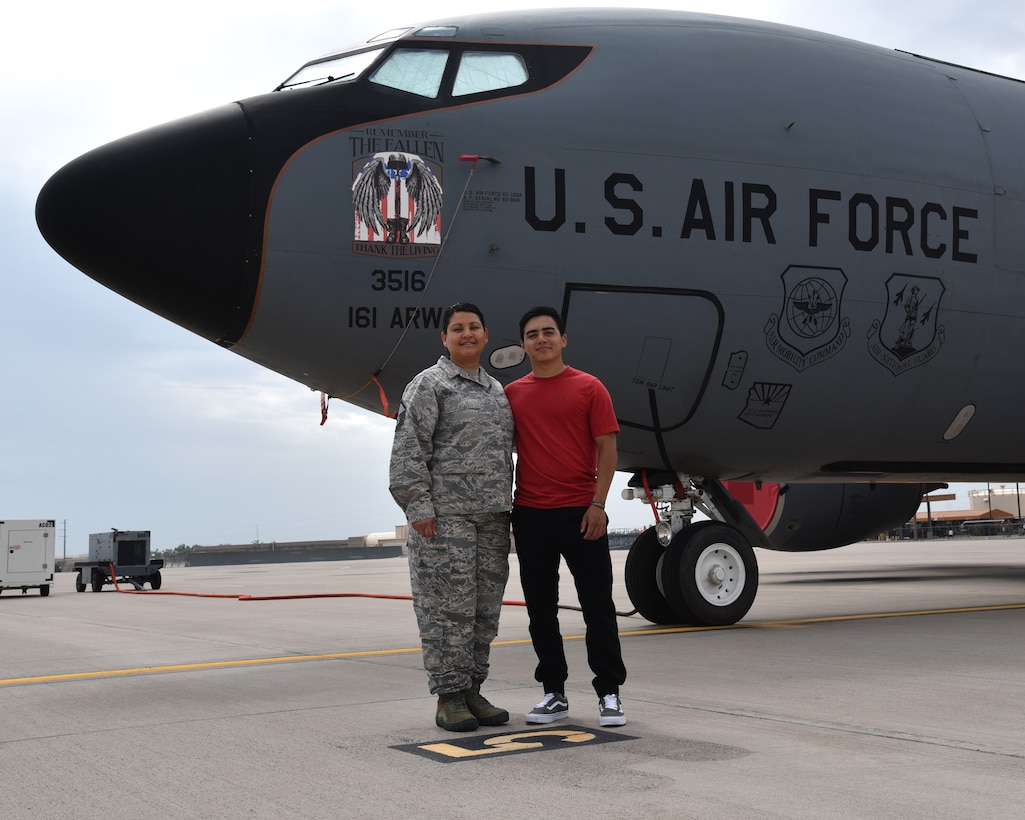 U.S. Air Force Master Sgt. Maria Breceda, the 161st Air Refueling Wing's administrative assistant, poses with her son, U.S. Army Pfc. Michael Breceda, an airborne infantryman with the 25th Infantry Division, in front of a KC-135R Stratotanker on the flight line at Goldwater Air National Guard Base, Phoenix, July 10. An aircrew from the 161st ARW conducting an in-flight refueling to A-10 Thunderbolt II's providing close air support to members of Private Breceda's battalion during ground combat April 30.  (U.S. Air National Guard photo by Staff Sgt. Wes Parrell)