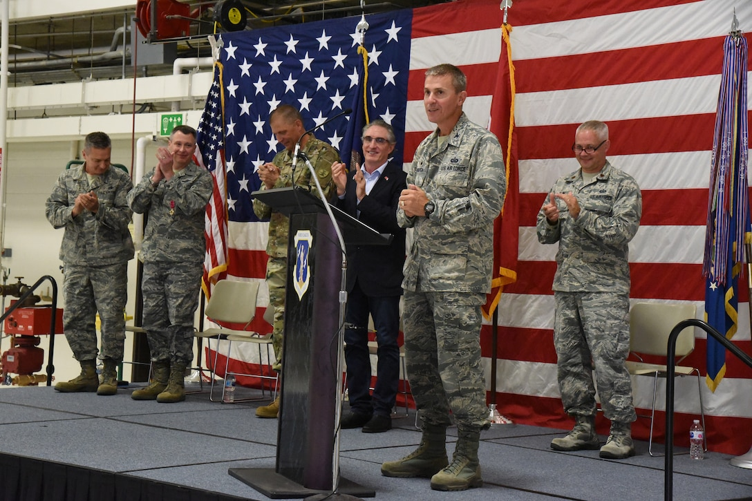 Col. Darrin Anderson, new 119th Wing commander, speaks to unit members during change of command ceremony at the North Dakota Air National Guard Base, Fargo, N.D., Aug. 4, 2018.
