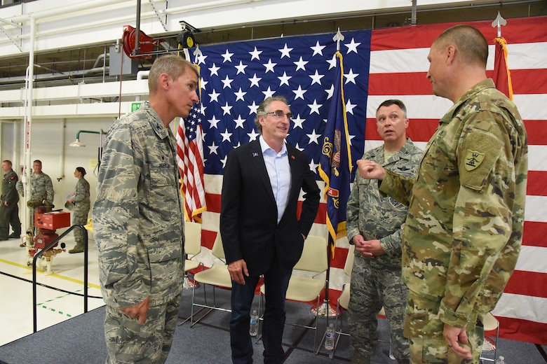 Gov. Doug Burgum visits with North Dakota National Guard leaders at change of command ceremony, Aug. 4, 2018.