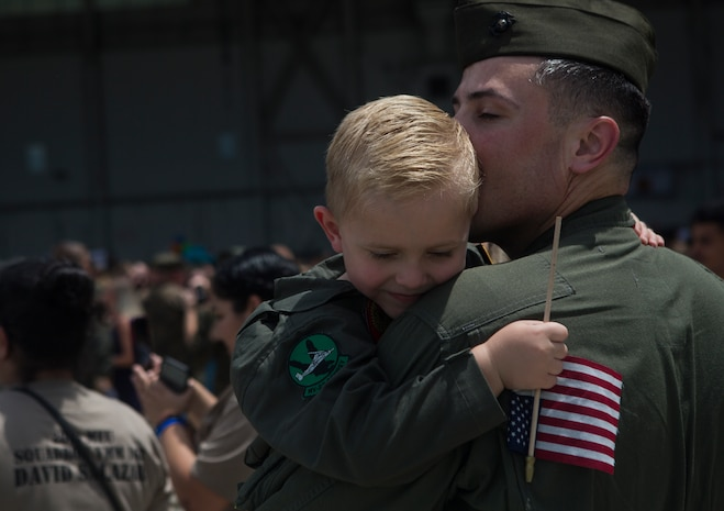 U.S. Marine Corps Capt. Joshua P. Hoppe, with the 26th Marine Expeditionary Unit, embraces his son at Marine Corps Air Station New River, Aug. 5, 2018. Marines with the 26th MEU returned home from a six-month deployment at sea to the U.S. Central, Africa and European Command areas of operation.