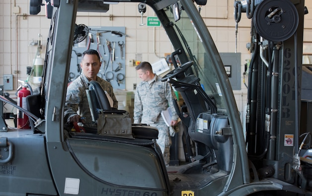An Airmen from the 124th Fighter Wing conducts a mock inspection during an occupational safety course at Gowen Field