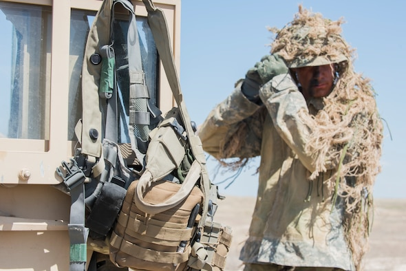 An Idaho Army National Guard sniper prepares for his first reconnaissance mission