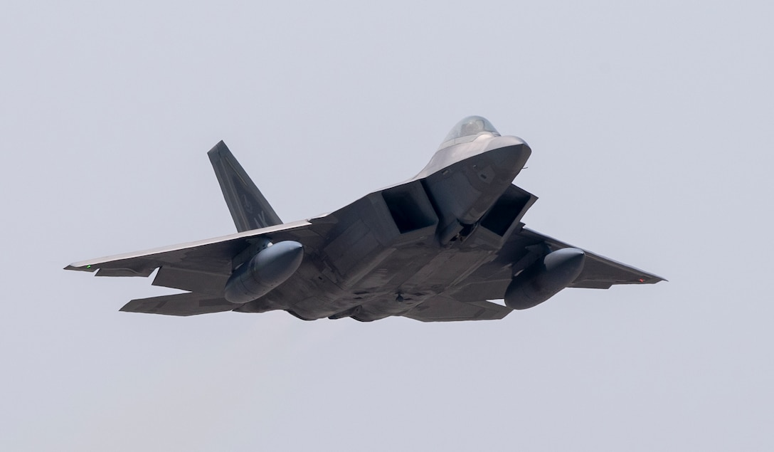 An F-22 Raptor from Joint Base Elmendorf-Richardson, Alaska takes off at Yokota Air Base