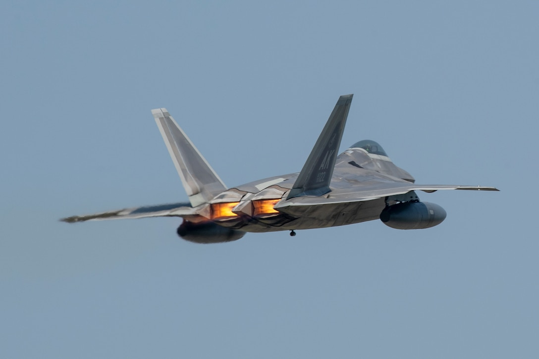 An F-22 Raptor from Joint Base Elmendorf-Richardson, Alaska takes off at Yokota Air Base