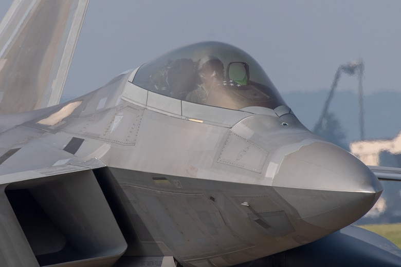 An F-22 Raptor taxis down the flightline at Yokota Air Base, Japan