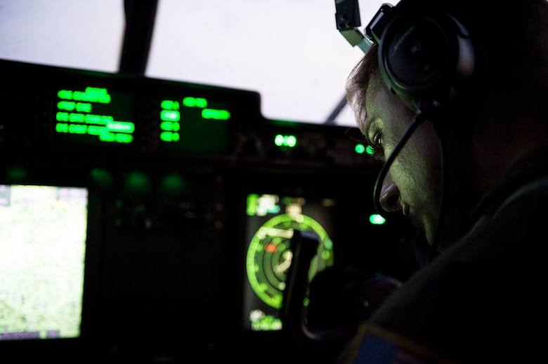 U.S. Air Force Capt. Pete Wolber, 37th Airlift Squadron C-130J Super Hercules pilot, operates the control panel of his aircraft during a training flight over Poland Aug. 2, 2018. Aircraft and Airmen from the 86th Airlift Wing have been conducting aviation detachment rotations since 2012. (U.S. Air Force photo by Senior Airman Joshua Magbanua)