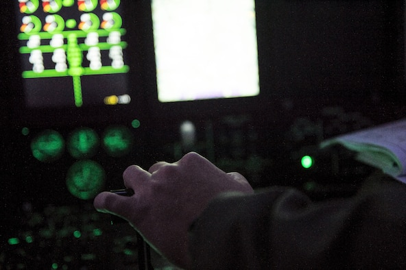 U.S. Air Force Capt. Pete Wolber, 37th Airlift Squadron C-130J Super Hercules pilot, operates the controls of his aircraft during a training mission over Poland, Aug. 2, 2018. U.S. C-130J pilots train to conduct various maneuvers such as tactical evasions, assault landings, and combat airdrops. (U.S. Air Force photo by Senior Airman Joshua Magbanua)