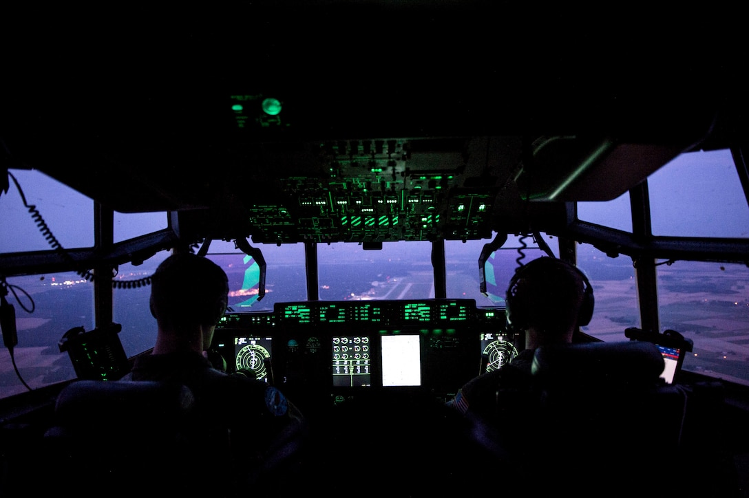U.S. Air Force Capt. Leland Quinter, left, and U.S. Air Force Capt. Pete Wolber, both 37th Airlift Squadron C-130J Super Hercules pilots, conduct a training flight over Poland, Aug. 2, 2018. Approximately 100 U.S. Airmen and three aircraft arrived in Poland to conduct bilateral exercises with the Polish Air Force. (U.S. Air Force photo by Senior Airman Joshua Magbanua)