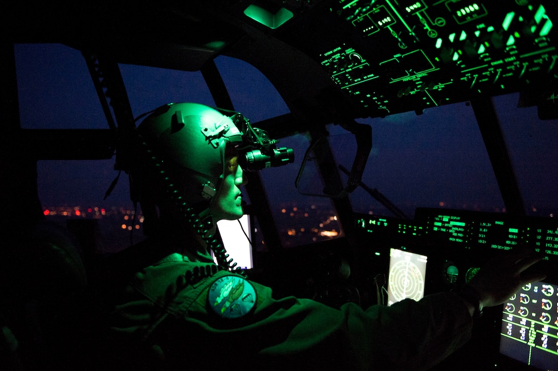 U.S. Air Force Capt. Leland Quinter, 37th Airlift Squadron C-130J Super Hercules pilot, wears night vision goggles during a training flight over Poland Aug. 2, 2018. U.S. C-130J pilots train to fly in multiple complex scenarios in various atmospheric conditions. (U.S. Air Force photo by Senior Airman Joshua Magbanua)