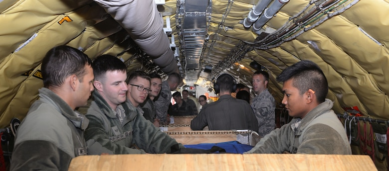 U.S. Air Force Airmen from 48th Fighter Wing and 100th Air Refueling Wing pack cargo inside a KC-135 Stratotanker preparing for a flight to Keflavik Air Base, Iceland, at RAF Mildenhall, England, July 30, 2018. U.S. Air Force Airmen and F-15 Eagles from the 48th Fighter Wing, RAF Lakenheath, England, deployed to Keflavik Air Base, Iceland, to conduct an Icelandic Air Surveillance rotation in support of NATO commitments.  (U.S. Air Force photo by Airman 1st Class Alexandria Lee)