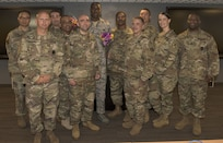 U.S. Air Force Master Sgt. Valentino Thorne, 87th Logistics Readiness Squadron superintendent of squadron readiness, poses with his Army classmates after a U.S. Army NCO Academy master leadership course graduation on Joint Base McGuire-Dix-Lakehurst, N.J., July 20, 2018. Thorne took the two-week class as a requirement of promotion to E-7 and graduated as the class leader with an overall 90 percent average. (U.S. Air Force photo by Airman Ariel Owings)