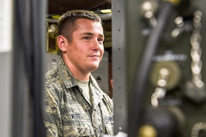 U.S. Air Force Airman 1st Class Randy West, 325th Communications Squadron radio frequency transmission systems apprentice, assesses radio equipment in the RF transmission systems shop at Tyndall Air Force Base, Florida, July 16, 2018.
