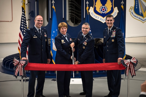 Col. Alden Hilton, United States Air Force School of Aerospace Medicine commander, Lt. Gen. Dorothy Hogg, Air Force Surgeon General, Maj. Gen. William Cooley, Air Force Research Laboratory commander, and Brig. Gen. Mark Koeniger, 711th Human Performance Wing commander, pose just before cutting the ribbon during a ceremony Aug. 2 in USAFSAM to mark the full operational capability of the Department of Defense's only human-rated centrifuge. (U.S. Air Force photo by Richard Eldridge)