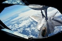 A 154th Wing Hawaii Air National Guard F-22 Raptor refuels from a 434th Air Refueling Wing KC-135 Stratotanker from Grissom Air Reserve Base, Indiana, while in flight near Hawaii during the Rim of the Pacific (RIMPAC) exercise July 17. Twenty-five nations, 46 ships, five submarines, and about 200 aircraft and 25,000 personnel are participating in RIMPAC from June 27 to Aug. 2 in and around the Hawaiian Islands and Southern California. The world's largest international maritime exercise, RIMPAC provides a unique training opportunity while fostering and sustaining cooperative relationships among participants critical to ensuring the safety of sea lanes and security of the world's oceans. RIMPAC 2018 is the 26th exercise in the series that began in 1971. (U.S. Air Force photo by Tech. Sgt. Samantha Mathison)