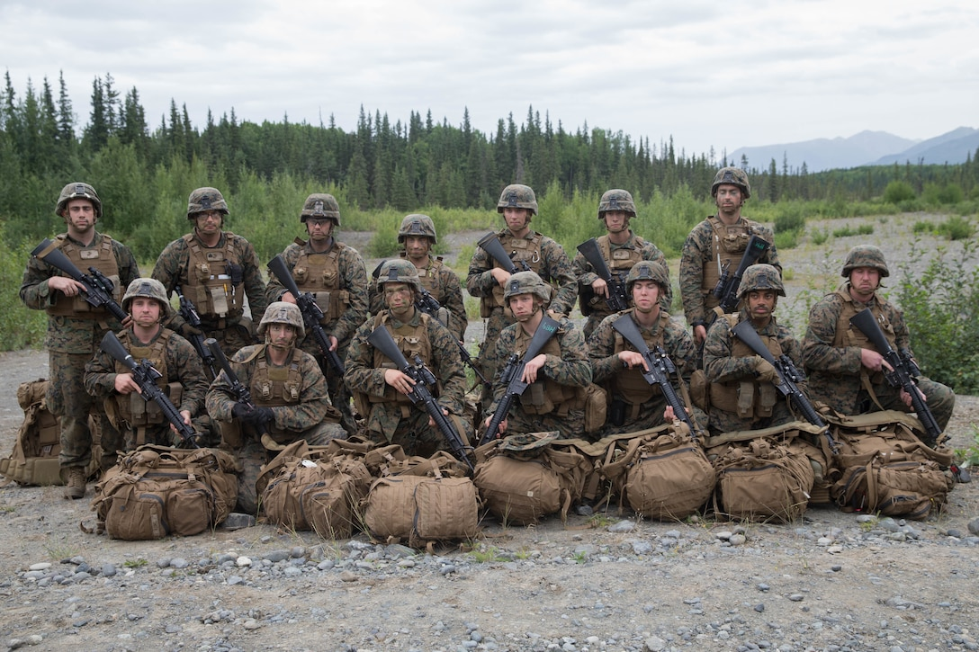 Marines with Charlie Company, 1st Battalion, 24th Marine Regiment competing in the 4th Marine Division Annual Rifle Squad Competition, pose for a photo at Joint Base Elmendorf-Richardson, Anchorage, Alaska, Aug. 3, 2018. Super Squad Competitions were designed to evaluate a 14-man infantry squad throughout an extensive field and live-fire evolution. (U.S. Marine Corps photo by Lance Cpl. Samantha Schwoch/released)