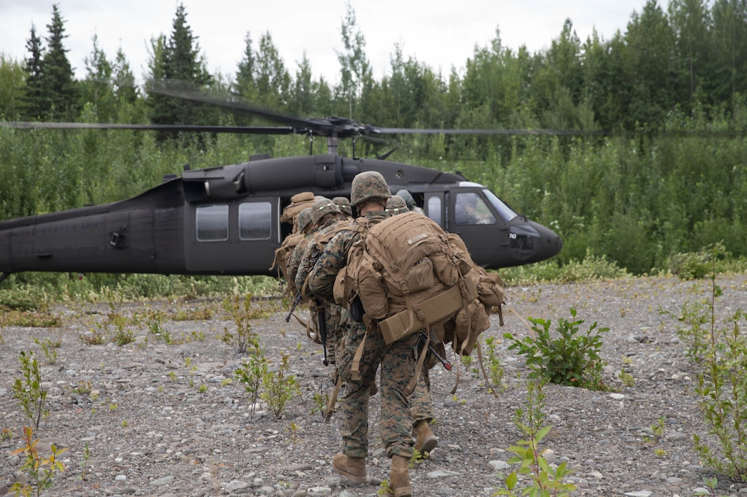 Marines with Charlie Company, 1st Battalion, 24th Marine Regiment, competing in the 4th Marine Division Annual Rifle Squad Competition, make their way to a U.S. Army Sikorsky UH-60 Black Hawk at Joint Base Elmendorf-Richardson, Anchorage, Alaska, Aug. 3, 2018. Super Squad Competitions were designed to evaluate a 14-man infantry squad throughout an extensive field and live-fire evolution. (U.S. Marine Corps photo by Lance Cpl. Samantha Schwoch/released)