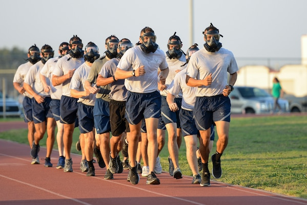 Air Education and Training Command Security Forces members wear gas masks as they preform physical exercises during AETC's Defender Challenge team selection July 27, 2018, at Joint Base San Antonio-Randolph, Texas. Defender Challenge is a Security Forces competition that pits teams against each other in realistic weapons, dismounted operations and relay challenge events.