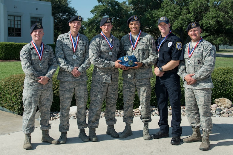 (left to right) Senior Airman William McLaughlin, 502nd Security Forces Squadron, Capt. Nathan Spradley, 902nd SFS, Technical Sgt. Cory Irvin, 37th Training Support Squadron, Senior Airman David Hightower, 56th SFS, Officer Jonathan Vance and Master Sgt. James Murray of the 802nd SFS, pose for a photo after being chosen as the representatives of Air Education and Training Command's Defender Challenge team July 27, 2018, at Joint Base San Antonio-Randolph, Texas. Defender Challenge is a Security Forces competition that pits teams against each other in realistic weapons, dismounted operations and relay challenge events.