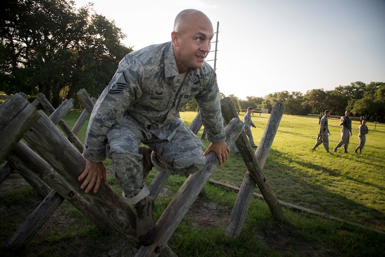 U.S. Air Force Airman Master Sgt. James Murray, 802nd Security Forces Squadron, jumps over an obstacle during the Air Education and Training Command's Defender Challenge team selection July 23, 2018, at Joint Base San Antonio-Camp Bullis, Texas. Defender Challenge is a Security Forces competition that pits teams against each other in realistic weapons, dismounted operations and relay challenge events.