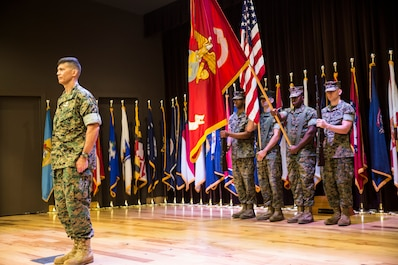 Brig. Gen. Mark Hashimoto, commander of Force Headquarters Group, stands at attention as the colors are presented in honor of Hashimoto taking command of FHG at the Federal City Auditorium, New Orleans, Aug. 3, 2018. Hashimoto relieved Maj. Gen. Michael F. Fahey, who served as the commander of FHG from 2016-2018. (U.S. Marine Corps photo by Sgt. Melissa Martens)