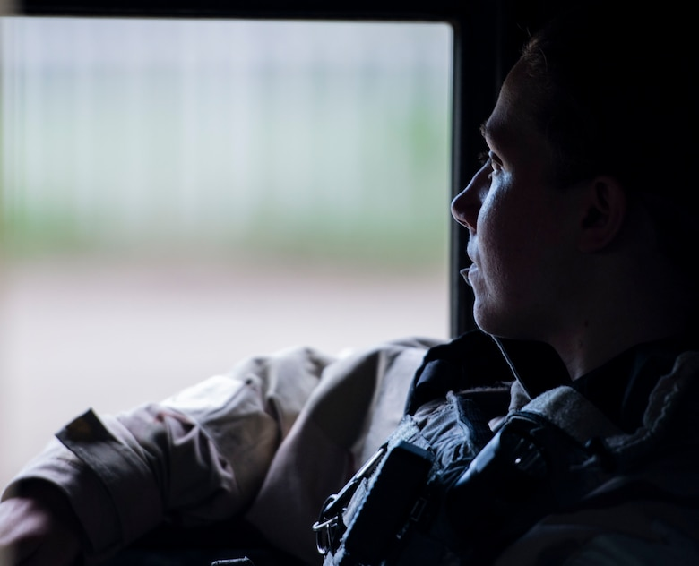 Senior Airman Taylor Pitts, 375th Security Forces Squadron patrolman, looks out the window of a Security Forces Humvee before patrolling the exercise zone during a base exercise, Aug. 2, 2018, at Scott Air Force Base, Illinois. Pitts was one of four 375th SFS Airmen tasked with patrolling the perimeter of the training area. (U.S. Air Force photo by Airman 1st Class Tara Stetler)