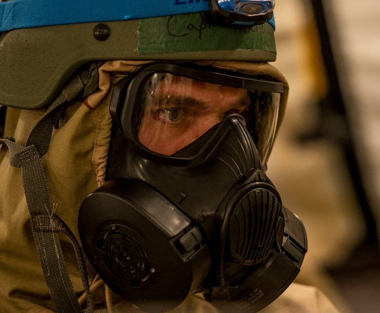 Capt. Brett Hutcherson, 375th Medical Operations Squadron family medicine faculty technician, checks his Airmen to ensure they properly put on their MOPP gear during a base exercise, Aug. 2, 2018, at Scott Air Force Base, Illinois. Airmen with the 375th MOS were responsible for tending to mock casualties after a simulated chemical attack. (U.S. Air Force photo by Airman 1st Class Tara Stetler)