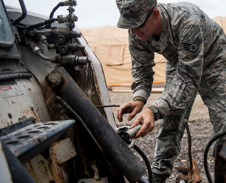 Staff Sgt. Chad Beasley, 375th Civil Engineer Squadron pavements and equipment craftsman, hooks-up a forklift during a base exercise, July 31, 2018, at Scott Air Force Base, Illinois. The exercise required coordination between active duty and reserve units on base, such as the 375th Air Mobility Wing and the 932 Airlift Wing. (U.S. Air Force photo by Airman 1st Class Tara Stetler)