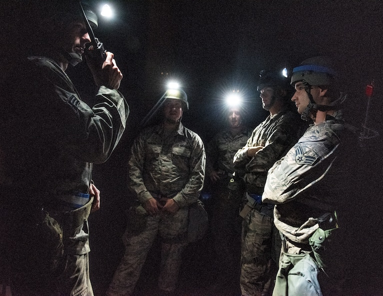 Senior Airman Max Shumate, 375th Civil Engineer Squadron structural journeyman, uses a hand-held radio to get direction from his leadership during a base exercise, Aug. 1, 2018, at Scott Air Force Base, Illinois. Shumate was part of a group of 375th CES Airmen responsible for responding to several simulated explosions near the training area. (U.S. Air Force photo by Airman 1st Class Tara Stetler)