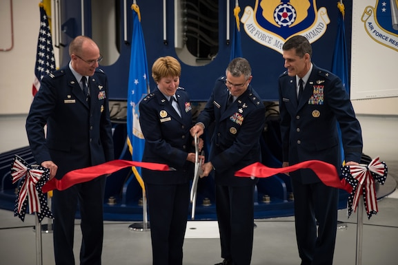 Col. Alden Hilton, United States Air Force School of Aerospace Medicine commander, Lt. Gen. Dorothy Hogg, Air Force Surgeon General, Maj. Gen. William Cooley, Air Force Research Laboratory commander, and Brig. Gen. Mark Koeniger, 711th Human Performance Wing commander, cutting the ribbon during a ceremony in USAFSAM to mark the full operational capability of the Department of Defense's only human-rated centrifuge, Aug. 2, 2018. (U.S. Air Force photo by Richard Eldridge)