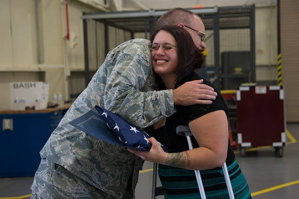 Maj. Eikner presents Ms. KaSandra Gray with a new flag flown over Afghanistan.