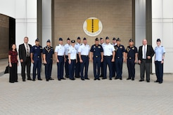Royal Thai air force leadership pose for a photo with Pacific Air Forces, 17th Training Wing and Air Force Security Assistance Training Squadron leadership outside the Norma Brown building during a tour on Goodfellow Air Force Base, Texas, Aug. 2, 2018. The overall intent for the visit was to share with RTAF partners how the U.S. Air Force organizes, trains and equips its intelligence professionals to achieve mission success. (U.S. Air Force photo by Senior Airman Randall Moose/Released)