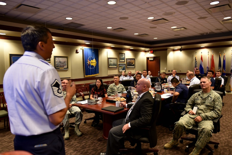 U.S. Air Force Master Sgt. Douglas Earl, 17th Training Group superintendent of standards and evaluations, presents a wing mission brief to Royal Thai air force, Pacific Air Forces and 17th Training Wing leadership in the Norma Brown building during a tour on Goodfellow Air Force Base, Texas, Aug. 2, 2018. The 17th TRW's mission is to train, develop and inspire exceptional intelligence, surveillance and reconnaissance and fire protection professionals for America and her allies. (U.S. Air Force photo by Senior Airman Randall Moose/Released)