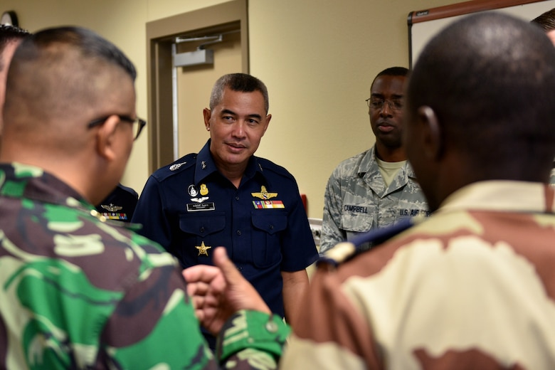 International military students provide Royal Thai air force Air Vice Marshall Pongsawat Jantasarn, their perspective on training alongside 315th Training Squadron students in the Consolidated Learning Center on Goodfellow Air Force Base, Texas, Aug. 2, 2018. The team observed a daylong-integrated analytics exercise by the 315th TRS's intelligence officer students and 11 international students from nine different countries. (U.S. Air Force photo by Senior Airman Randall Moose/Released)