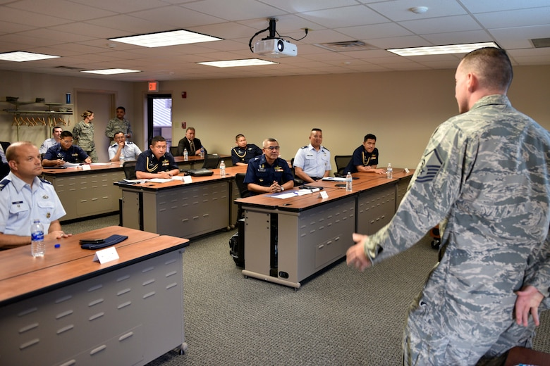 U.S. Air Force Master Sgt. Martin Smith, 315th Training Squadron flight chief, addresses Pacific Air Forces and Royal Thai air force leaders on how the base trains geospatial intelligence professionals in the International Intelligence Training Center on Goodfellow Air Force Base, Texas, Aug. 2, 2018. The IITC, which opened in January 2018, provides the International Intelligence Applications Officer Course. (U.S. Air Force photo by Senior Airman Randall Moose/Released)