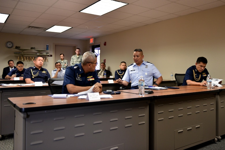 U.S. Air Force Lt. Col. Abraham Salomon, 17th Training Group deputy commander, highlights 17th Training Wing's international training to Royal Thai air force Air Vice Marshall Pongsawat Jantasarn, in the International Training Center on Goodfellow Air Force Base, Texas, Aug. 2, 2018. The visit reinforced the 17th TRG's vision to set the standard for fully integrated intelligence training and education. (U.S. Air Force photo by Senior Airman Randall Moose/Released)