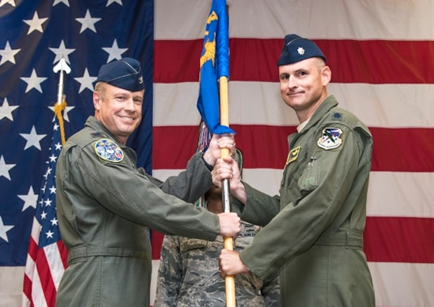 Lt. Col. Matthew Johnson, right, accepts the 5th Flying Training Squadron guidon from Col. Allen Duckworth, 340th Flying Training Group commander, during an assumption-of-command ceremony held July 31 at Vance Air Force Base, Oklahoma. (U.S. Air Force photo/ Terry Wasson)