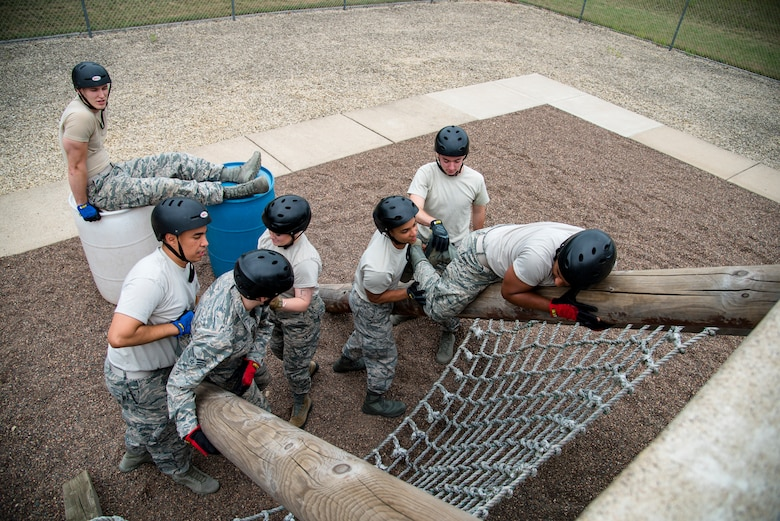 Wisconsin Air National Guard junior enlisted Airmen navigate through the leadership development course July 26, 2018, at Volk Field Air National Guard Base, Wisconsin. The Airmen were participants of the 2018 Junior Enlisted Orientation Program which allows junior enlisted Airmen to better understand the mission of all the units in the Wisconsin Air National Guard. 
