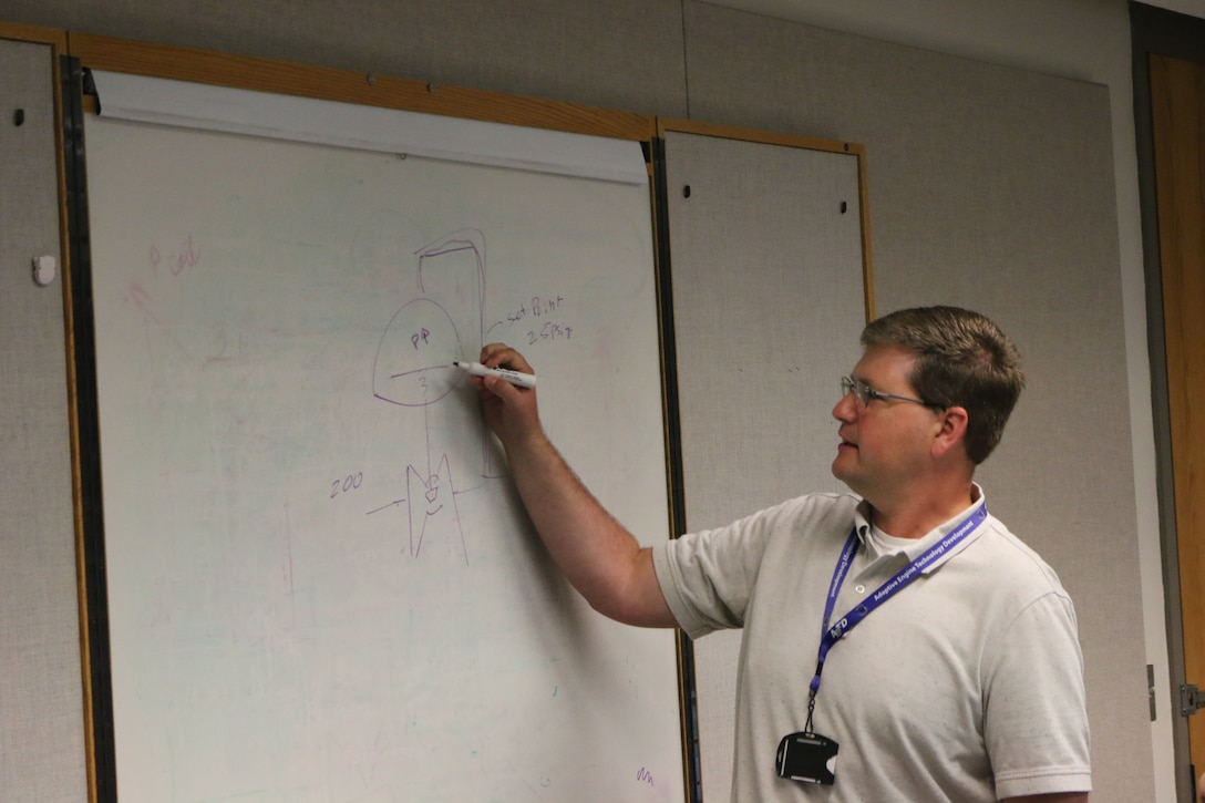 Austin Voorhes, a senior mechanical design engineer at Arnold Air Force Base, discusses steam regulators during a lunch and learn session in the Carroll Building on July 25. Voorhes was recently recognized for establishing the lunch and learns at Arnold. More than 100 lunch and learns have been held since Voorhes began the effort a little more than three years ago. (U.S. Air Force photo by Bradley Hicks)