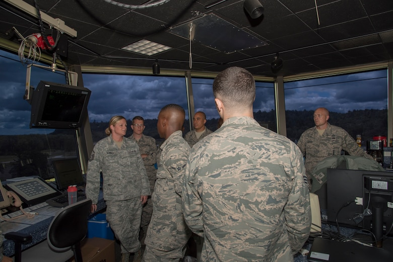Junior enlisted Airmen, with the Wisconsin Air National Guard, tour Volk Field's Air Traffic Control Tower July 26, 2018, at Volk Field Air National Guard Base, Wisconsin. The Airmen were participants of the 2018 Junior Enlisted Orientation Program which allows junior enlisted Airmen to better understand the mission of all the units in the Wisconsin ANG.(U.S. Air National Guard photo by Airman Cameron Lewis)
